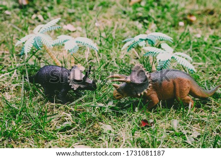 T REX Dinosaurs model on grass background strong reptile toy