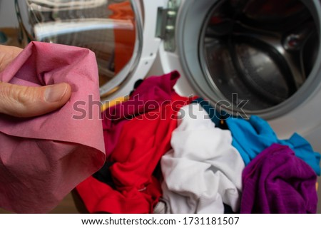 A colour catcher sheet used in a washing machine. The color catcher for laundry keeps the original colors of clothes and garments during washing