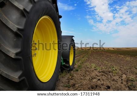 The Tractor - modern farm equipment in field #17311948