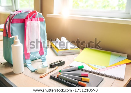 Back to school after quarantine concept. Backpack with school supplies and sanitizer and medical protective mask. the beginning of the school season.  #1731210598