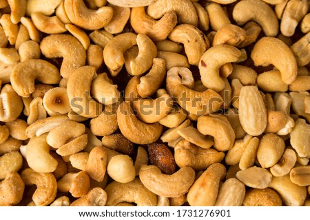 full-screen cashew nut roasting and salting background