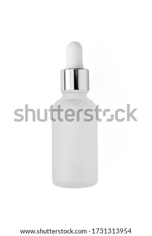 Frosted glass bottle with dropper with silver metallic cup isolated on white background, top view. Mockup cosmetic product Royalty-Free Stock Photo #1731313954
