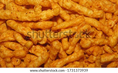 Healthy crunchy snack,Kurkure snack,Evening Snack or the Tea Snack,Kurkure is an evening snack that is manufactured using edible ingredients like rice meal, Background Texture.                        #1731373939