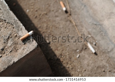 Cigarette placed on the floor. selective focus #1731416953