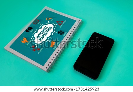 online marketing scheme on Notepad for business .There's a phone next to it