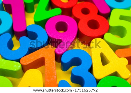 Image of early childhood education, many colorful numbers on yellow background