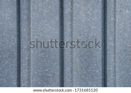 Fragment of a metal flooring. Macro photo. Metal flooring. Surface texture of the protective coating. Relief and folds on a sheet of metal corrugated cardboard. Rough metal surface. #1731685120