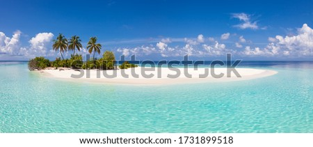 Small desert island with idylic lagoon in tropical climate of Indian ocean. Royalty-Free Stock Photo #1731899518