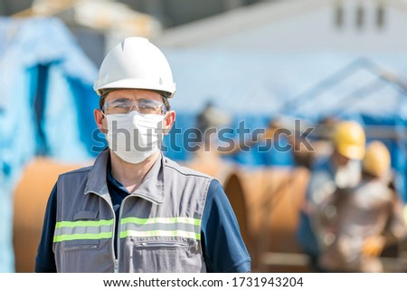 The worker is using personal protective equipments. For healthcare professionals caring for people with covid-19, the CDC recommends placing the person in an airborne infection isolation room. Royalty-Free Stock Photo #1731943204