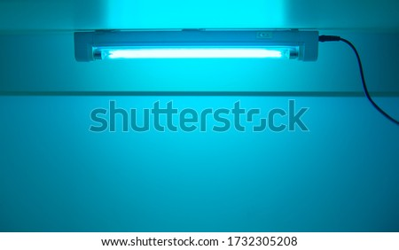 UV lamp sterilization of air and surfaces. Ultraviolet light from the lamp in laboratory. Coronavirus epidemic prevention concept. Copy space Royalty-Free Stock Photo #1732305208