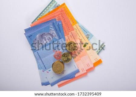 Stack Malaysia Bank note with coin on White Background.