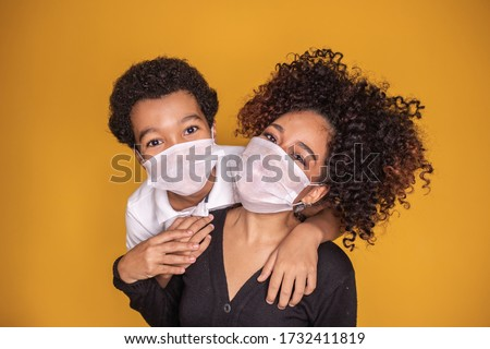 Portrait of young African American mother with toddler son using mask. mother and son wearing mask to protect covid 19, quarantine. Stay at home concept.  #1732411819