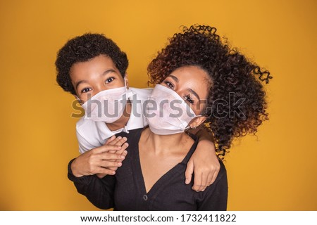 Portrait of young African American mother with toddler son using mask. mother and son wearing mask to protect covid 19, quarantine. Stay at home concept.  Royalty-Free Stock Photo #1732411822