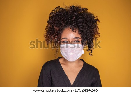 young girl wearing protective mask in corona virus pandemic, covid-19 Royalty-Free Stock Photo #1732414246
