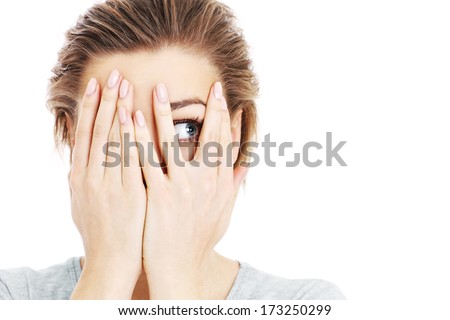 A picture of a scared woman covering her eyes over white background #173250299