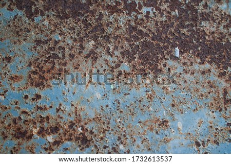 Abstract old rusty metal picture.dirty dirt and brown grain on blue steel background, suitable for graphic design and retro,vintage image style