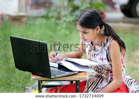 A young rural Indian girl is studying online.Study in lock down. Online school classes. Schools closed due to Covid-19. Role of technology during nationwide lock down.Learning at home.  Royalty-Free Stock Photo #1732724009