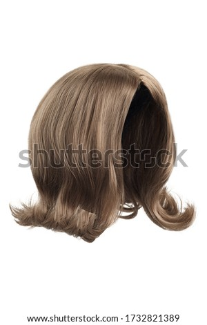 Subject shot of a natural looking ashy brown wig without bangs. The shoulder-long wig with twisted strands is isolated on the white background.  Royalty-Free Stock Photo #1732821389