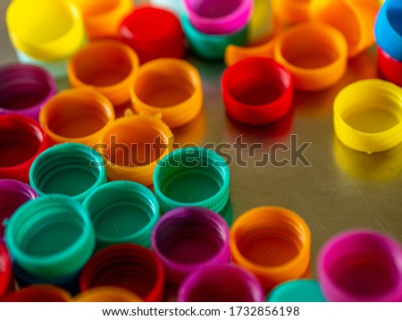 Colorful plastic Bottles caps used to fill homeopathic pills/globules #1732856198
