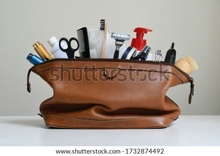 Toiletry Travel Bag with personal items Royalty-Free Stock Photo #1732874492