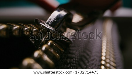 Close up shot of zip fastener being opened Royalty-Free Stock Photo #1732914473