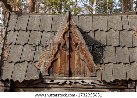 roof an old small wooden abandoned hunting Lodge in the woods #1732955651