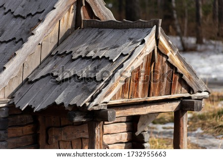 roof an old small wooden abandoned hunting Lodge in the woods #1732955663