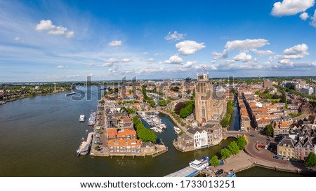 Dordrecht Netherlands, skyline of the old city of Dordrecht with church and canal buildings in the Netherlands #1733013251