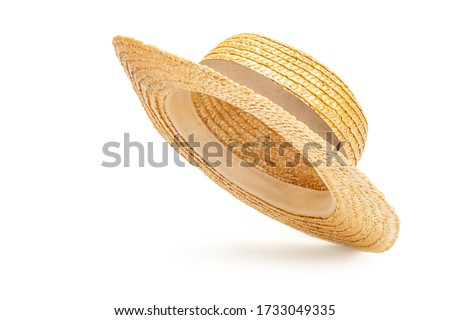 Boater straw hat flying isolated in studio. Concept of fashion clothing accessories and beach holidays Royalty-Free Stock Photo #1733049335