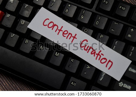 Content Curation write on sticky note isolated on wooden table.
