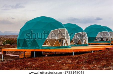 Green geo-dome tent on Kamchatka peninsula. Cozy, camping, glamping, holiday, vacation lifestyle concept. Outdoors cabin, scenic background Royalty-Free Stock Photo #1733148068