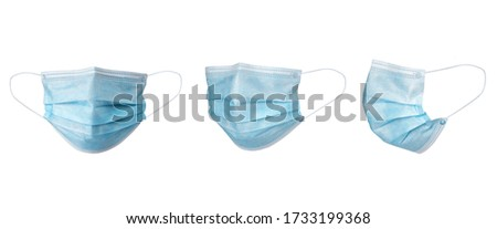 Medical face mask isolated on white background with clipping path around the face mask and the ear rope. Concept of COVID-19 or Coronavirus Disease 2019 prevention by wearing face mask. #1733199368