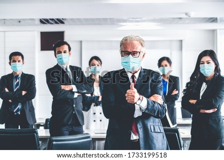 Confident business people with face mask protect from Coronavirus or COVID-19. Concept of help, support and collaboration together to overcome epidemic of Coronavirus or COVID-19 to reopen business. #1733199518