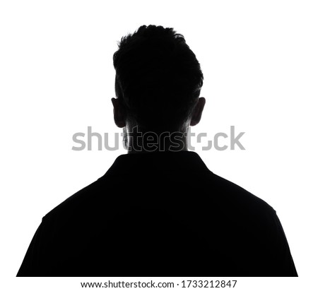 Silhouette of male person , back view back lit over white  Royalty-Free Stock Photo #1733212847