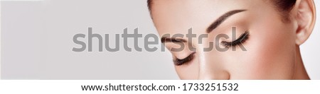 Beautiful Woman with Extreme Long False Eyelashes. Eyelash Extensions. Makeup, Cosmetics. Beauty, Skincare Royalty-Free Stock Photo #1733251532