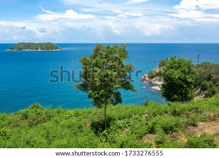 Tropical seascape. Empty beaches, turquoise calm sea, palm trees, coral reef under water - asian tropical paradise. Blue ocean water in a tropical lagoon on jungle covered island #1733276555