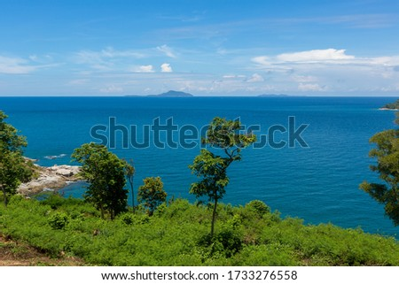 Tropical seascape. Empty beaches, turquoise calm sea, palm trees, coral reef under water - asian tropical paradise. Blue ocean water in a tropical lagoon on jungle covered island #1733276558