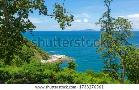 Tropical seascape. Empty beaches, turquoise calm sea, palm trees, coral reef under water - asian tropical paradise. Blue ocean water in a tropical lagoon on jungle covered island #1733276561