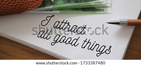 Text showing I Attract All Good Things and 100 Euro banknotes Positive attraction law Motivation Affirmation Concept. Royalty-Free Stock Photo #1733387480