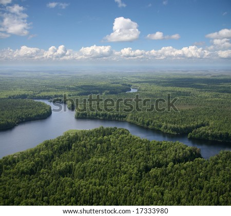 The View overhand the river on green forest plain. #17333980