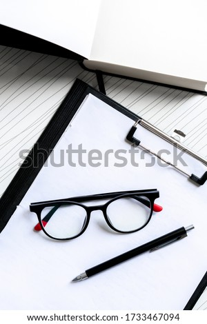 A student desk with glasses #1733467094