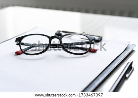 A student desk with glasses #1733467097