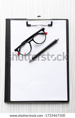 A student desk with glasses #1733467100