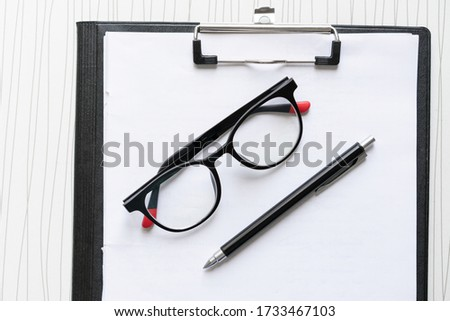 A student desk with glasses #1733467103