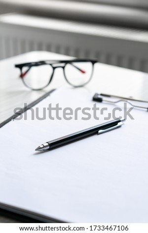 A student desk with glasses #1733467106
