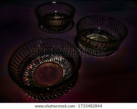 Glowing glass bowls shinning under dim light exposure. A concept infocus pic of grocery with selective focus.