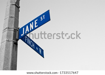 Jane Street and Finch Avenue W street sign at the corner of the intersection. Royalty-Free Stock Photo #1733517647
