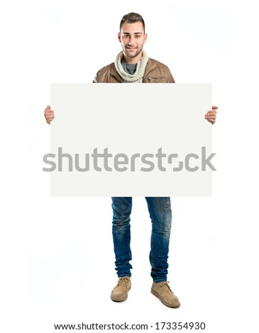 handsome man holding an empty cardboard over white background #173354930
