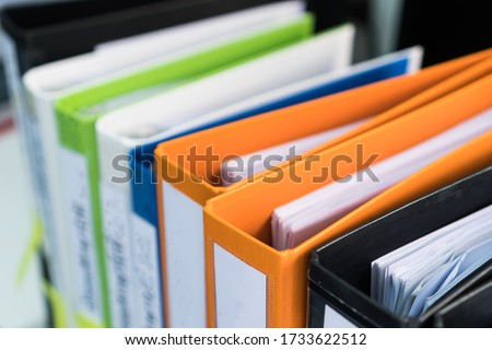 Document binder file folders stack on office desk in organization with report paper, paperwork record label, A lot of work information for businessman or lawyer organized archive database bookkeeping Royalty-Free Stock Photo #1733622512