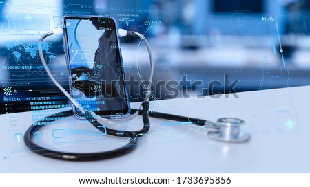 Tele medicine concept,Medical Doctor online communicating the patient on VR medical interface with Internet consultation technology Royalty-Free Stock Photo #1733695856